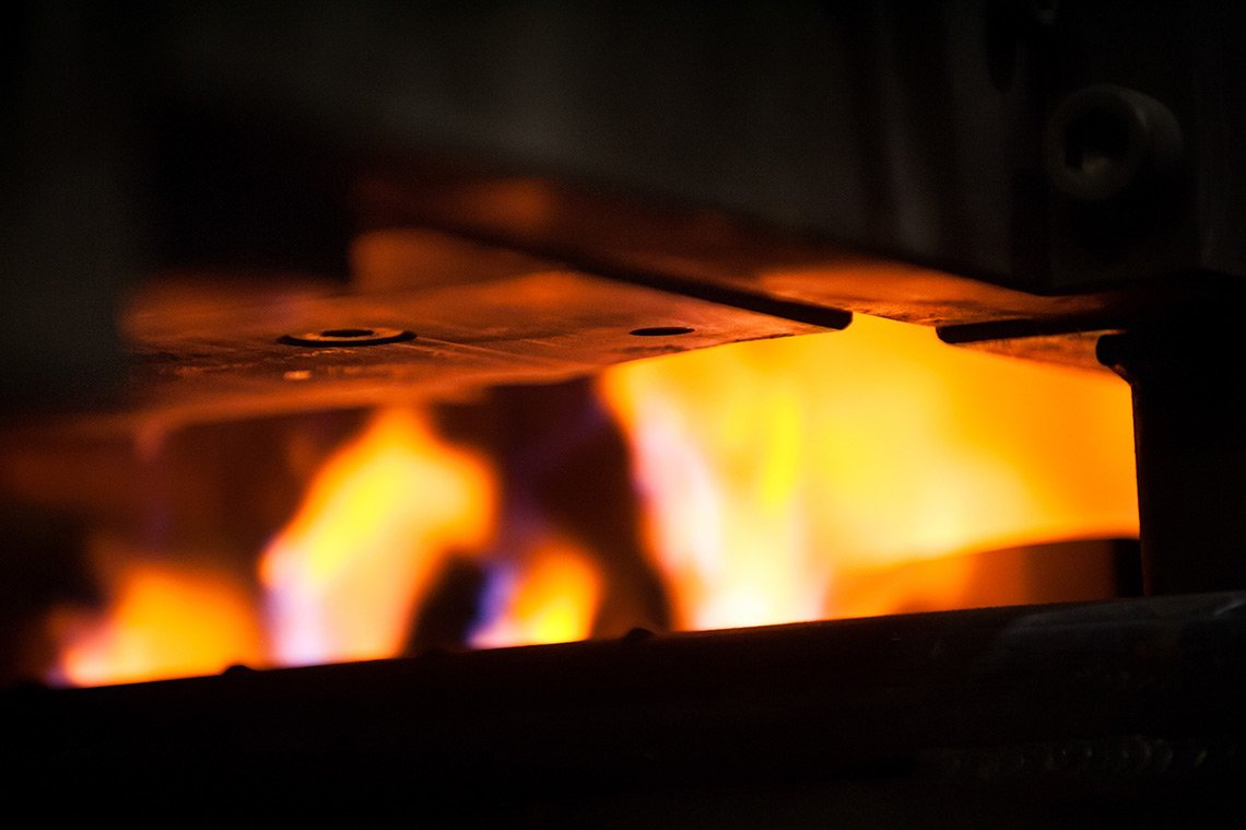 The flames inside a foundry machine at Atek Precision Castings in Iowa