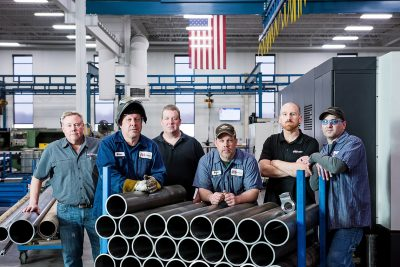 Industrial photo of a group of five workers at aggressive Hydraulics in Mpls MN