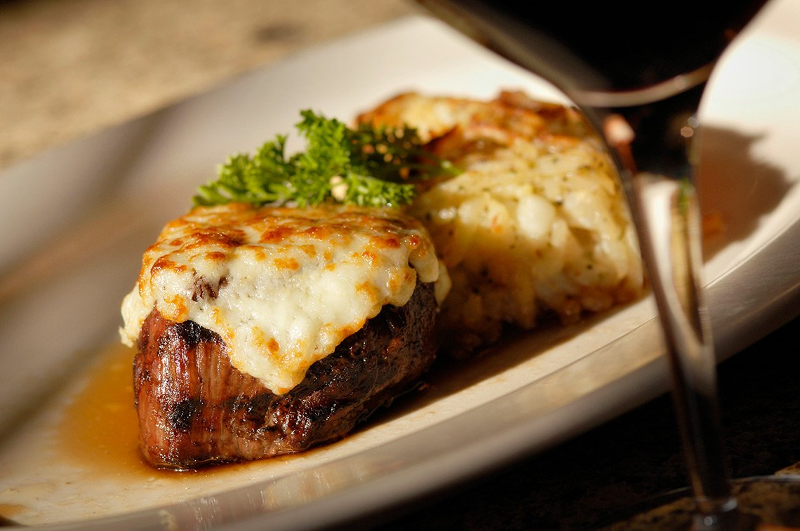 Food photography of cheese covered steak at Chester's in Rochester MN