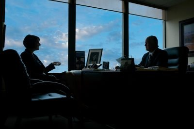 Two attorneys meet in an office in Minneapolis Minnesota