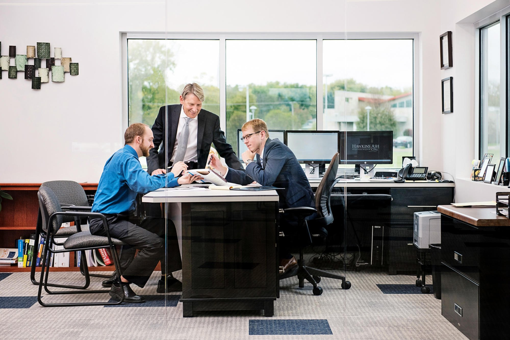 Corporate photography of accountants looking over paperwork.