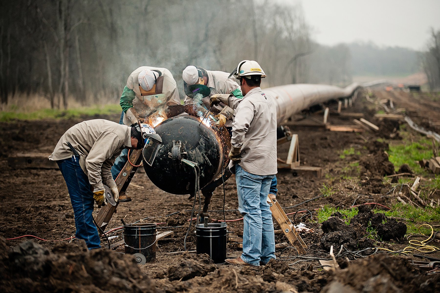 Industrial photography of an oil pipeline installation in Texas.