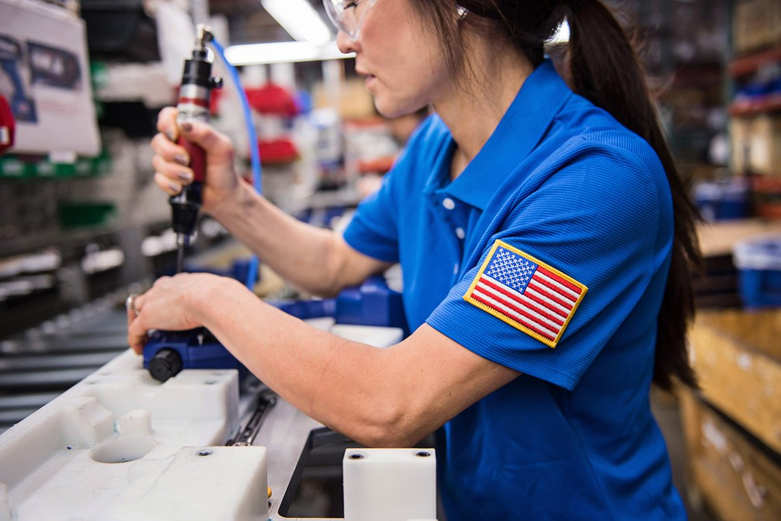 Industrial photography of a female assembly line worker at Graco Inc in Minneapolis Minnesota