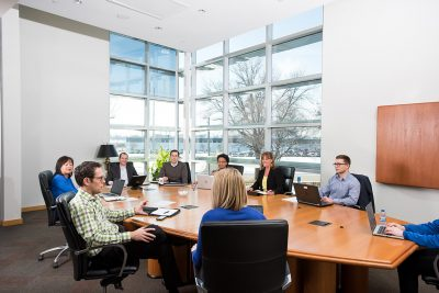 Corporate photography of an executive meeting at Graco in Minneapolis, MN