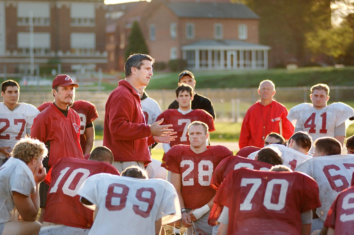 Lifestyle photo of college football team at practice.