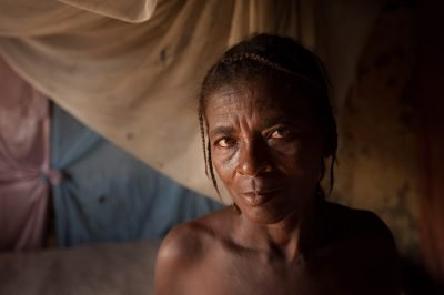 Environmental portrait of a Haitian woman inside her Fort Liberte home