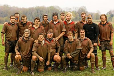The Grove City College rugby team after their final game played in the mud