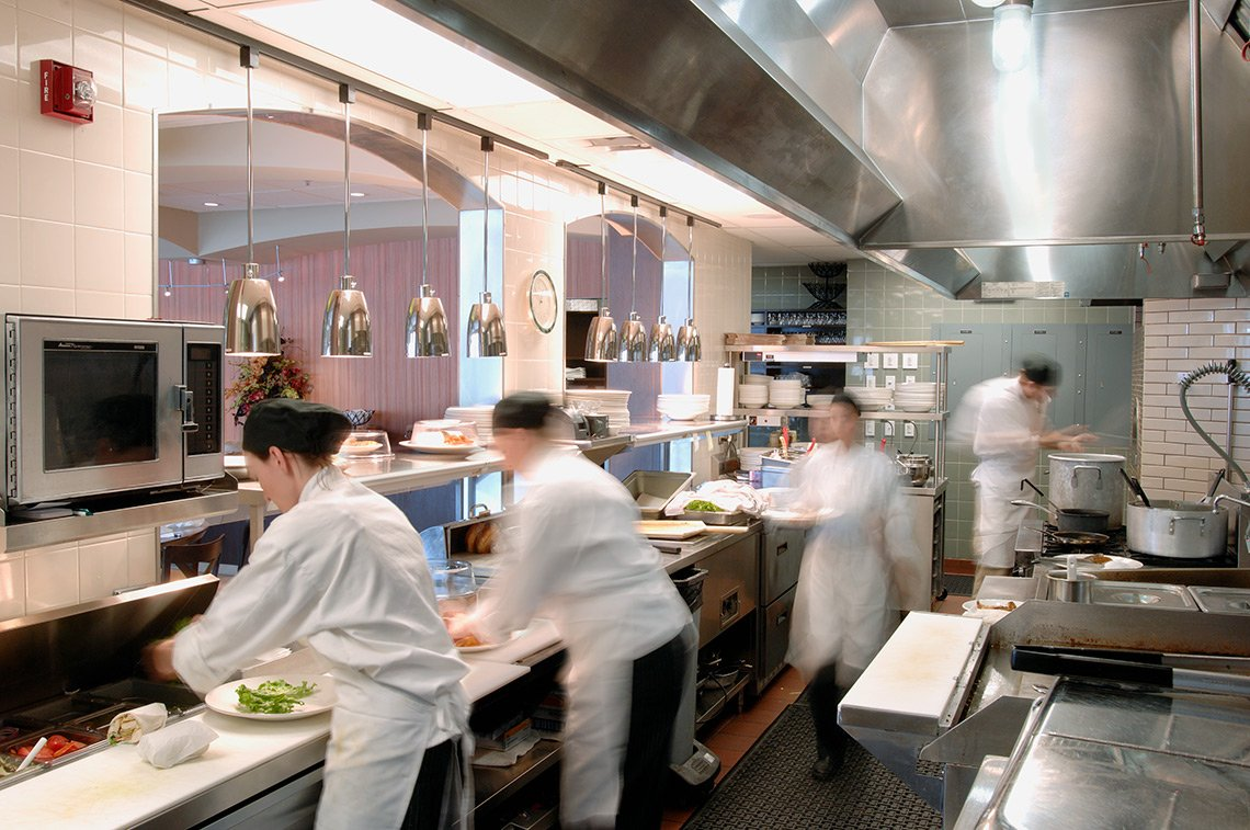 Hospitality photo of a busy restaurant kitchen area.