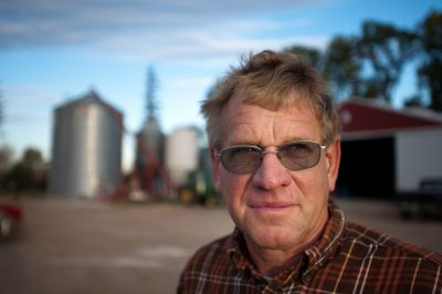 Environmental portrait of a farmer on his Minnesota farm.