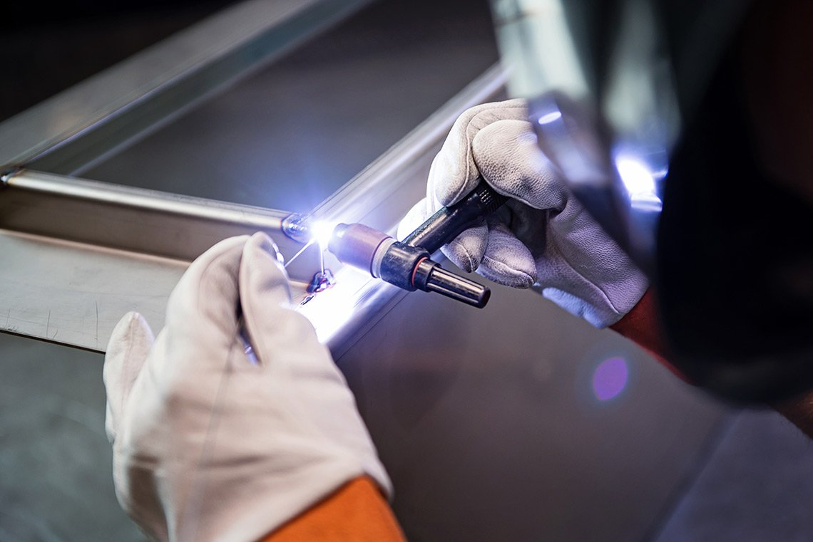 Tight industrial photograph os welding being performed