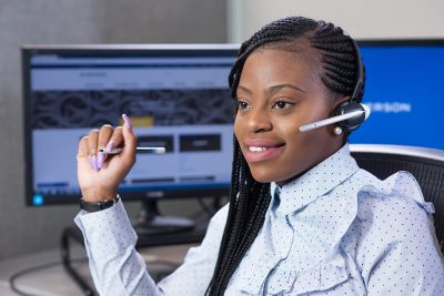 Corporate photography of an employee at Ryerson's call center in Mpls MN.