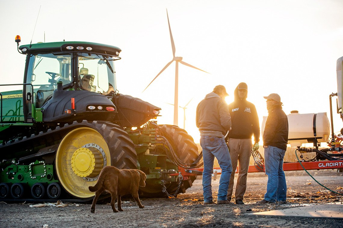 A quick meeting before heading out in the combines on a farm in Minnesota.