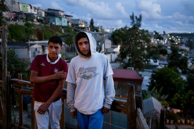 Two teenage boys on a deck in their Tijuana Mexico neighborhood