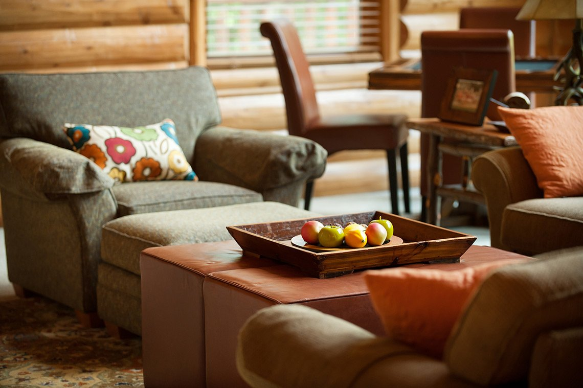 The seating area in a living room of a beautiful cabin in Minnesota