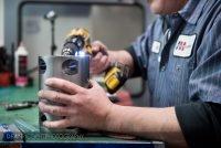 Assembling parts at Aggressive Hydraulics in Minneapolis, Minnesota
