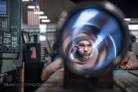 A worker inspects a hydraulic cylinder at Aggressive Hydraulics in Minneapolis, Minnesota