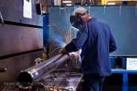 A worker welds at Aggressive Hydraulics in Minneapolis, Minnesota