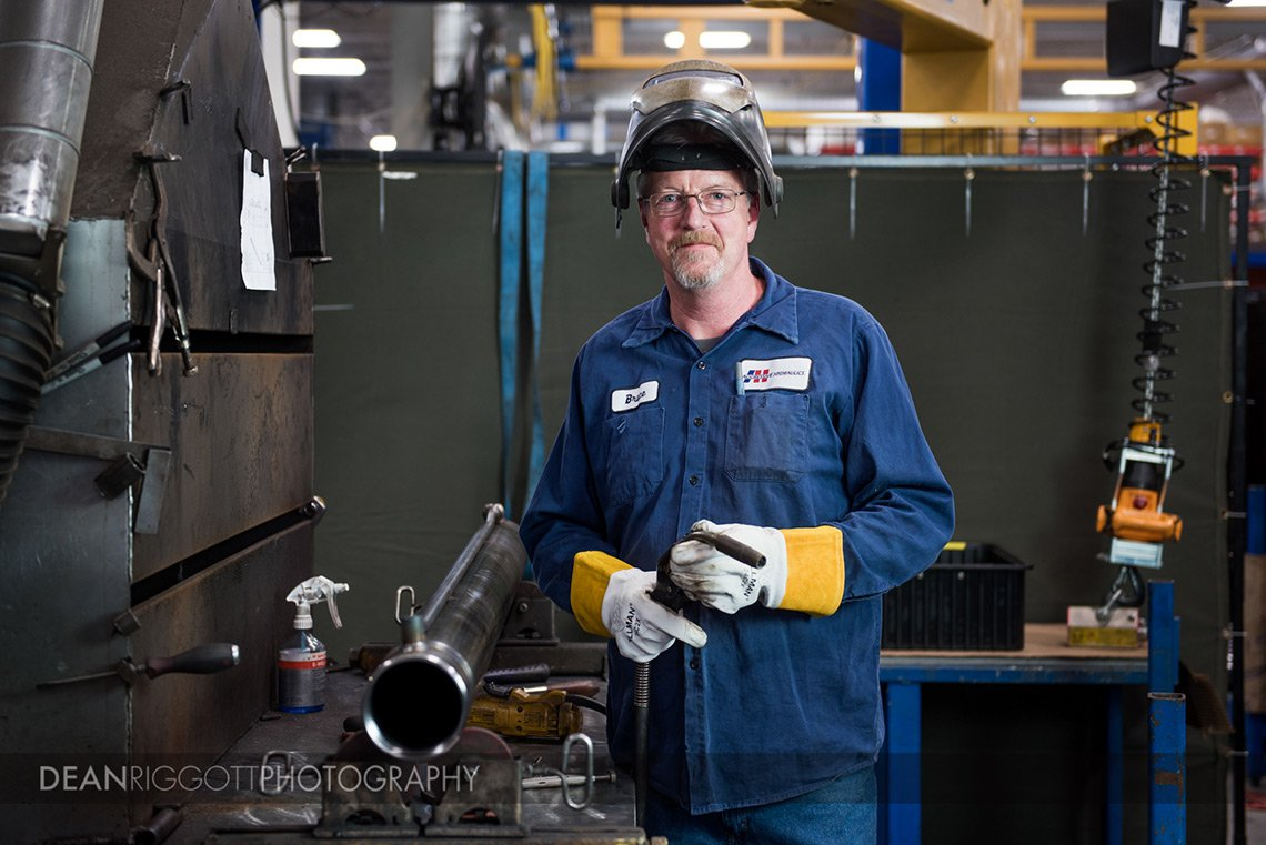 An industrial photography portrait of a welder at Aggressive Hydraulics in Minneapolis, Minnesota
