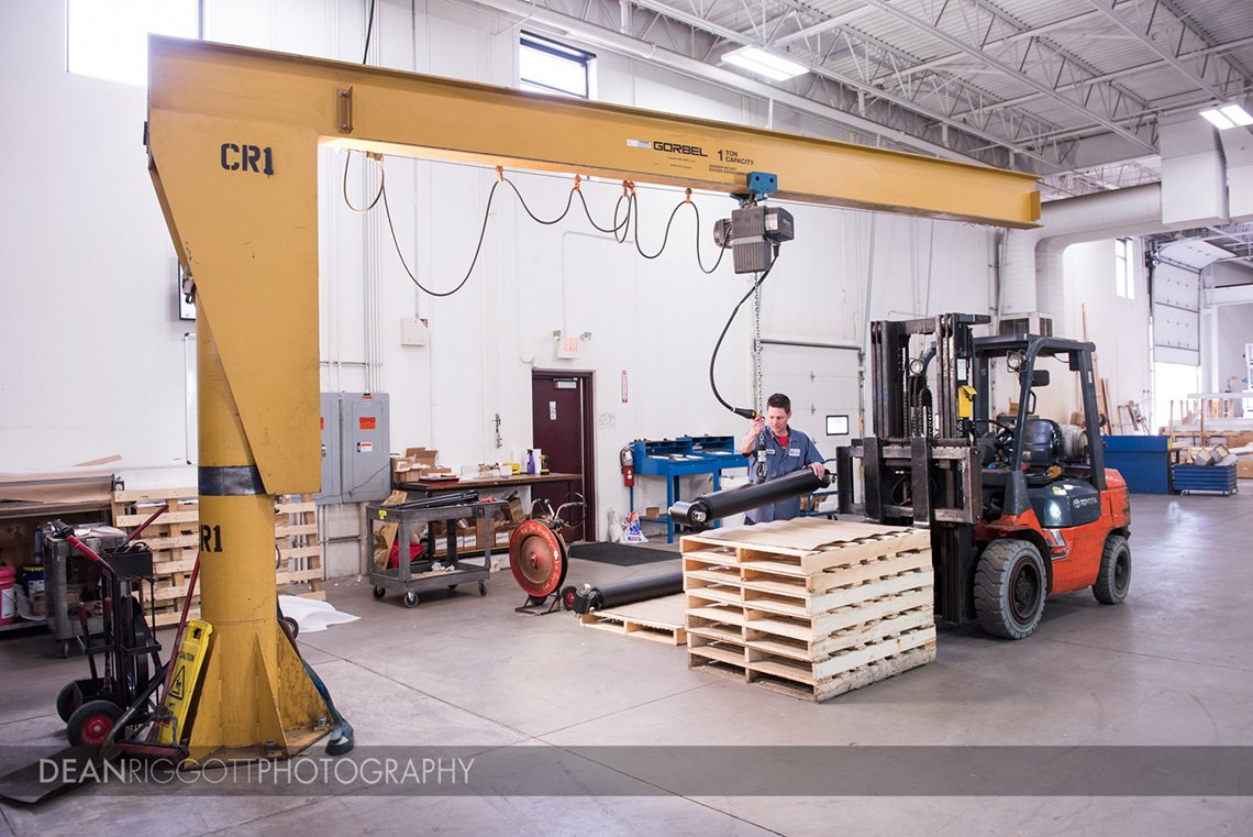 Loading hydraulic cylinders at Aggressive Hydraulics in Minneapolis, Minnesota.