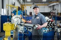 Portrait of an industrial employee at Aggressive Hydraulics in Minneapolis, Minnesota.