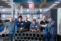 Group photo of employees at Aggressive Hydraulics in Minneapolis, Minnesota.
