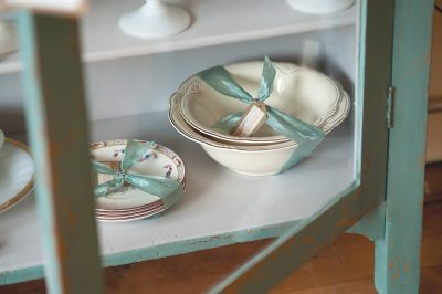 Vintage china in a cabinet at Adourn in Chatfield, MN