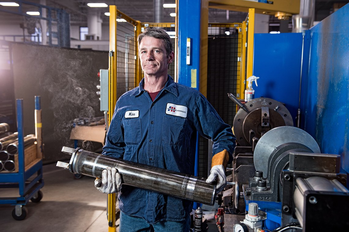 Industrial photography of metal worker at Aggressive Hydraulics in Minneapolis, Minn.
