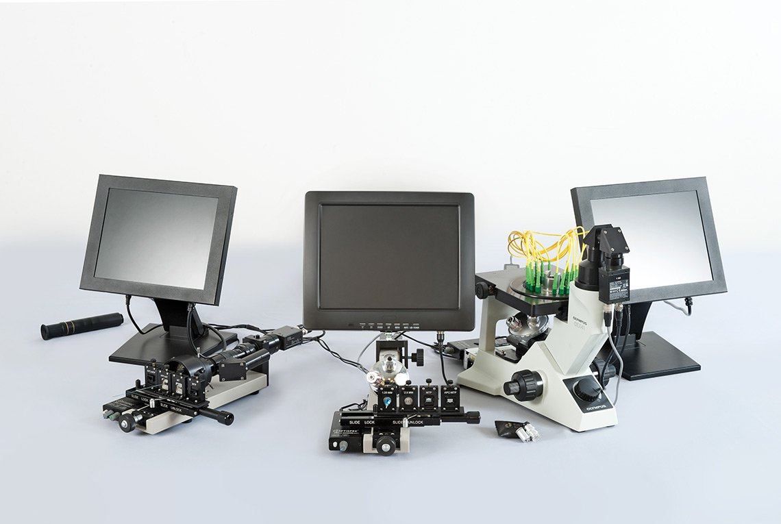 Product photo of lab devices and computer monitors for Domaille Engineering