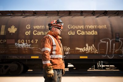 Worker for Canadian Pacific Railroad standing alongside a train