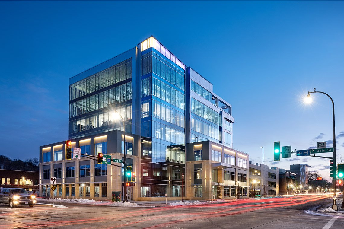 Nighttime architectural photo of the Eide Bailly building in Mankato, MN