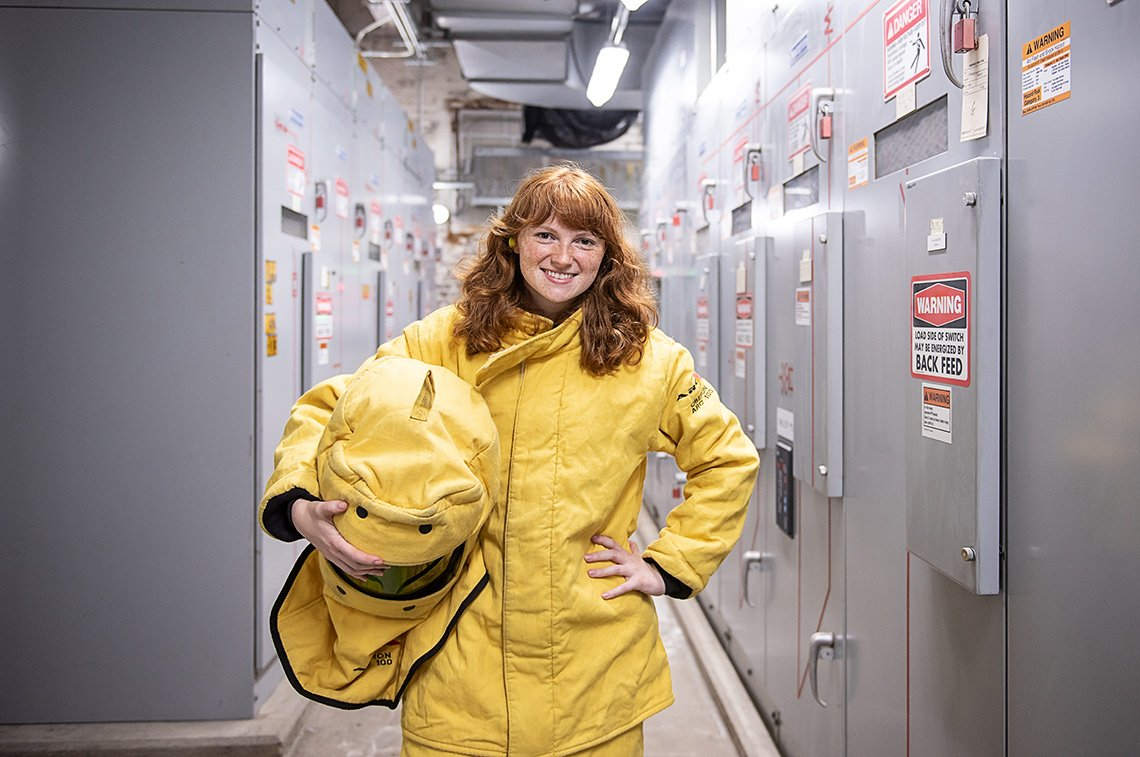Industrial photography portrait of a female worker in a safety suit at a power station in St Paul, MN