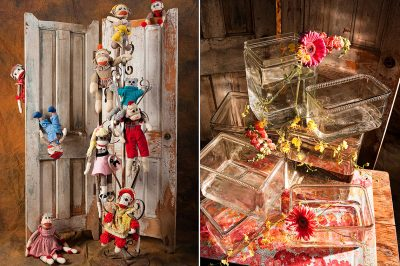 Product photo of stuffed monkeys hanging on to old doors and glass containers with flowers