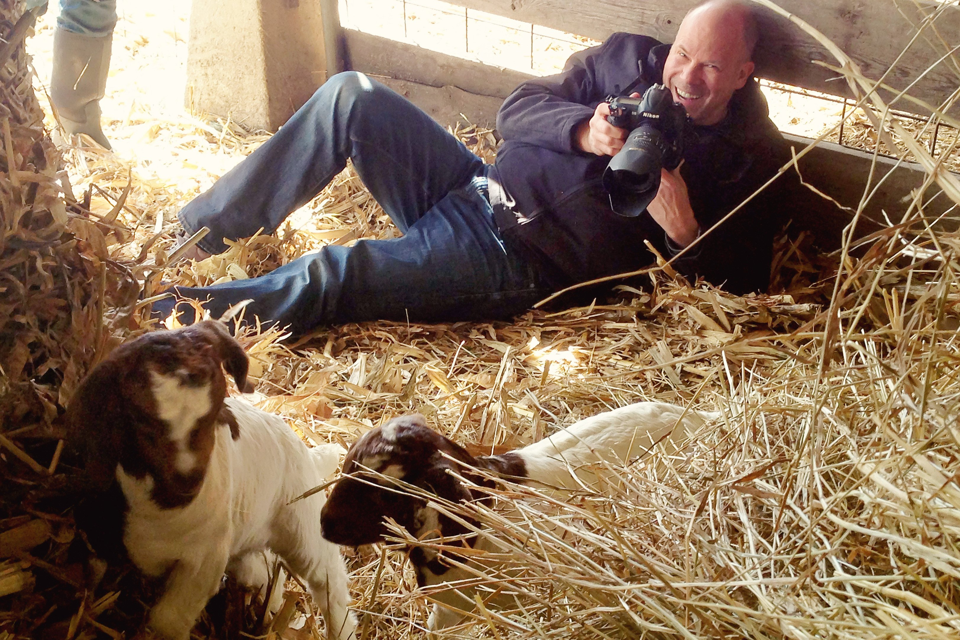 Dean Photographing baby goats on a farm in Iowa.