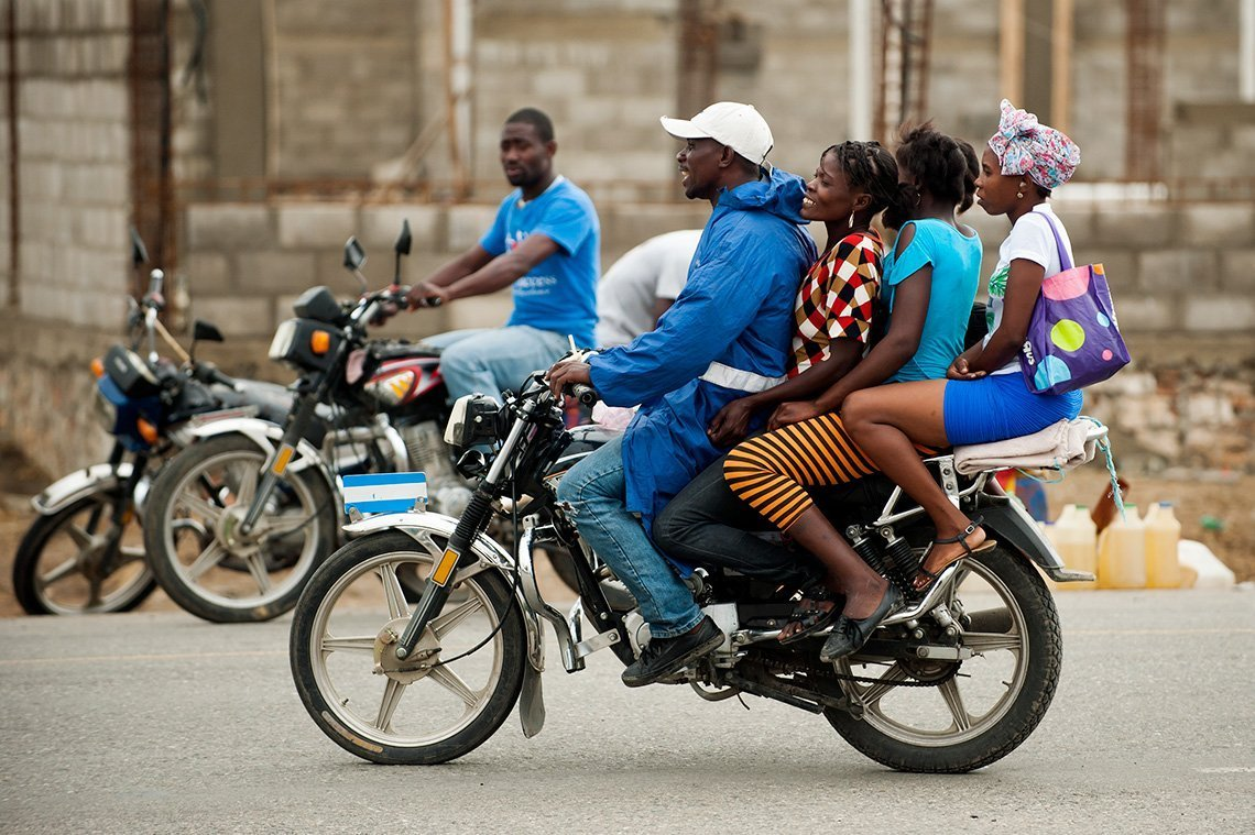 Haitian group on a motorbike