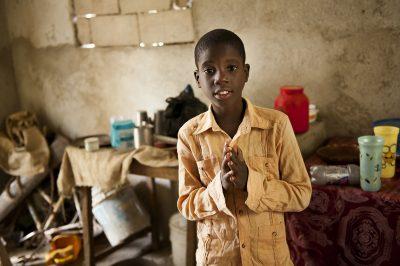 A boy in his Fort Liberte, Haiti, home