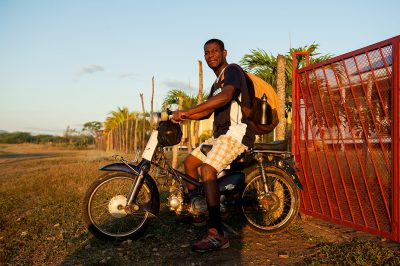 A man leaves for work on his old mope-head in Fort Liberte Haiti