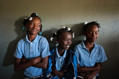 Three girls at a private catholic school in Haiti