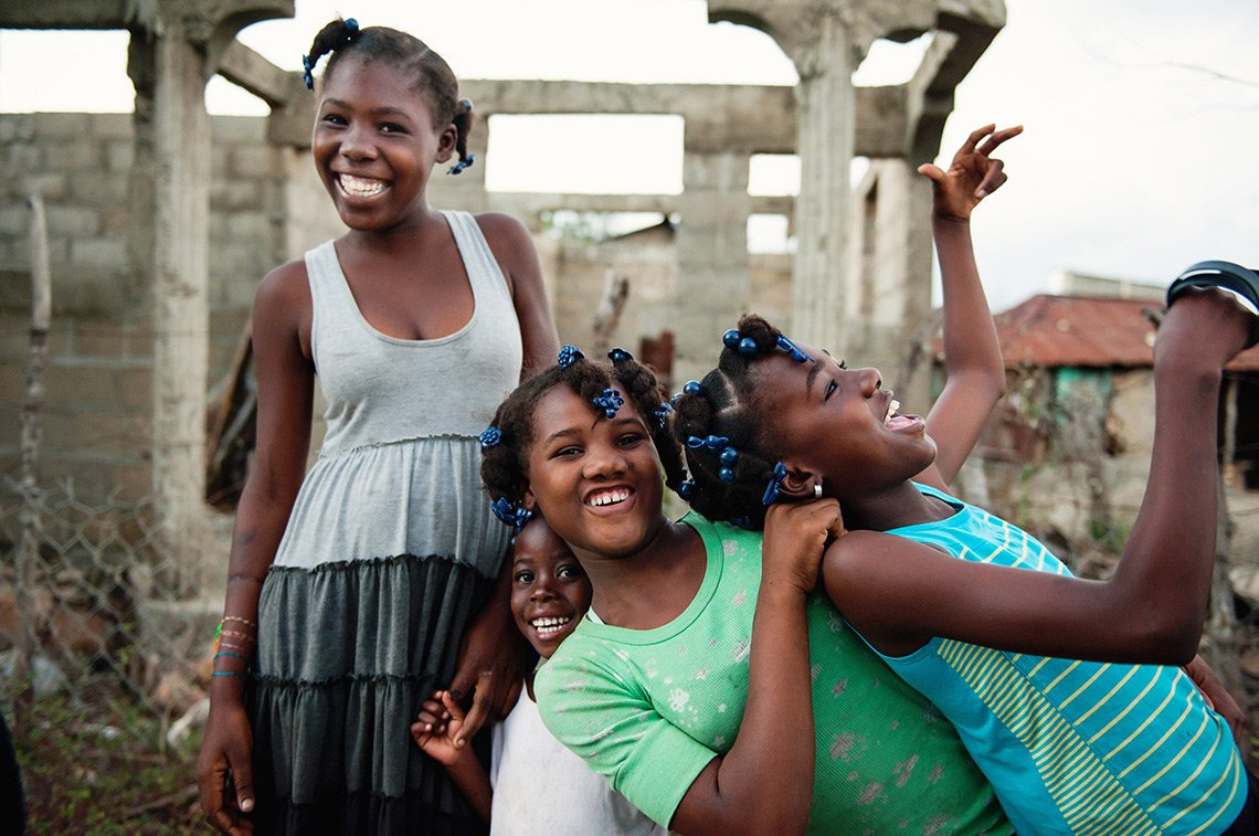 Four girls goofing around and laughing in Haiti