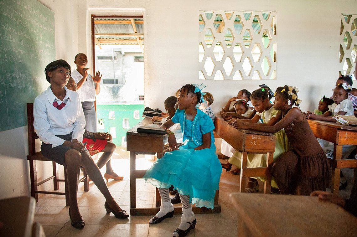 Kids in a church classroom in Fort Liberte Haiti