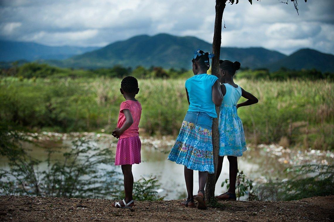 Haitian girls looking over grassland