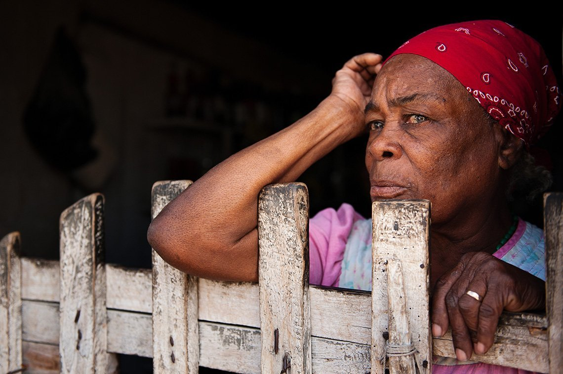 Haitian woman looking out