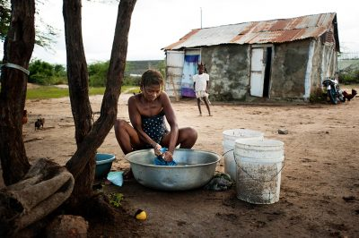 A mother of six children washing clothes in Fort Liberte, Haiti.