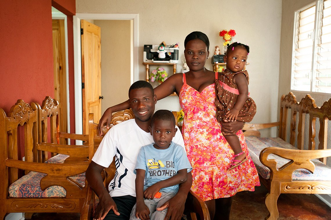 A young family in their living area in Fort Liberte, Haiti.