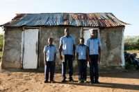 Four brothers on their way to school in Fort Liberte, Haiti.
