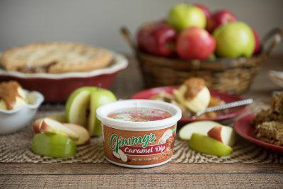 Product photo of Jimmy's Caramel Dip surrounded by apples, ice cream and apple pie.