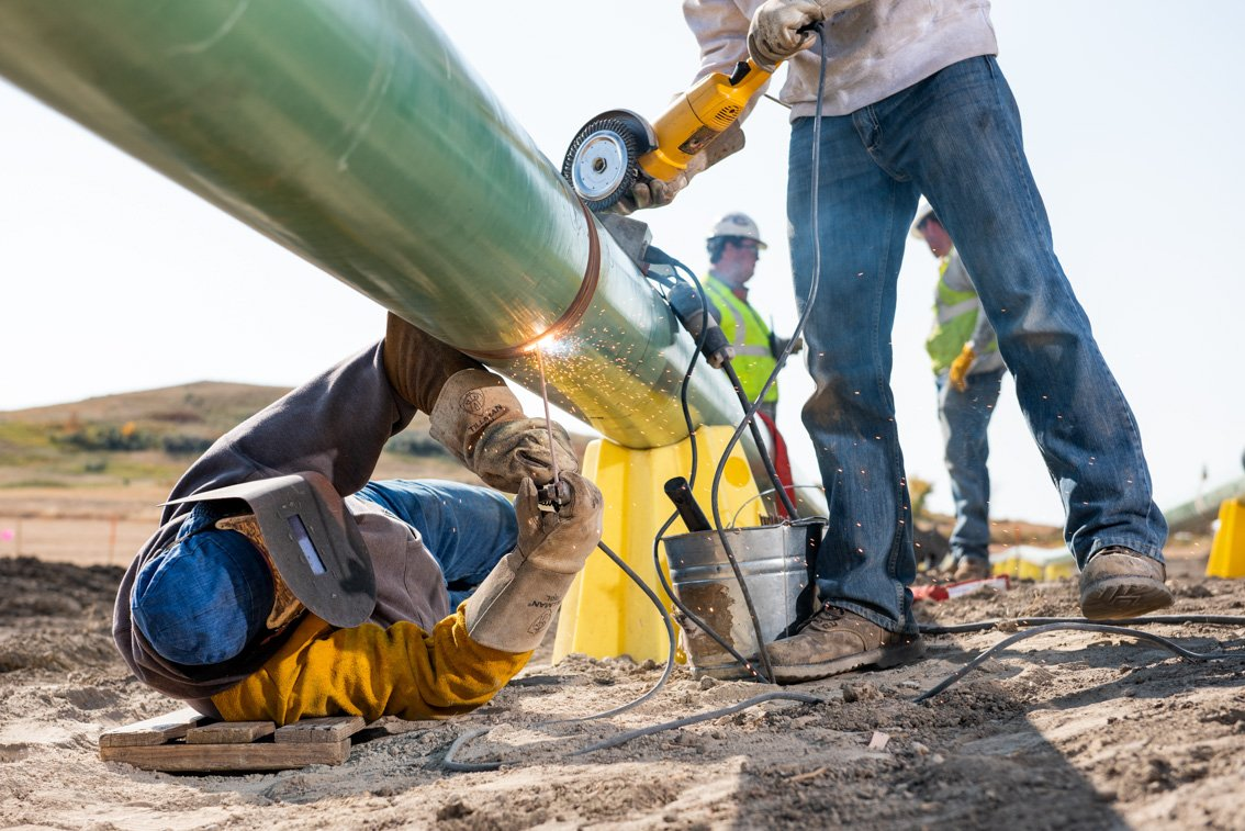 Industrial photo of welding an oil pipeline in SD