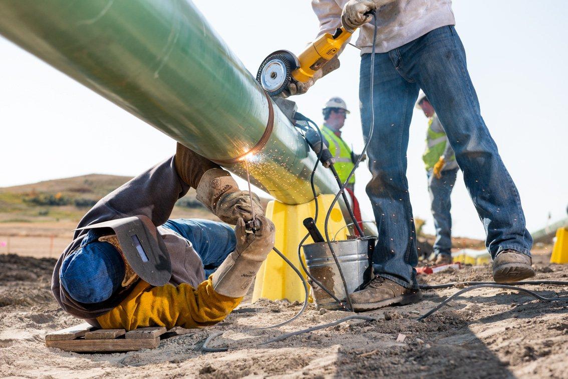 Industrial photo of welding an oil pipeline in SD