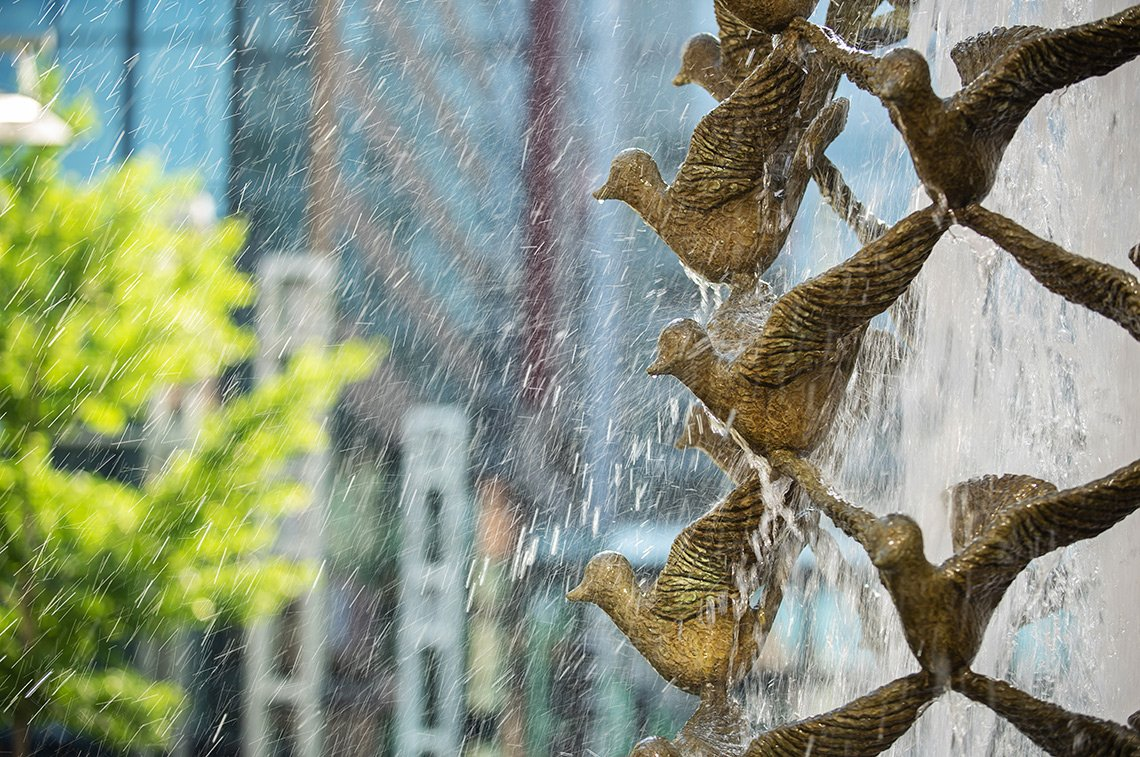 Water spatters off the Peace Fountain doves in the Peace Plaza in downtown Rochester mn