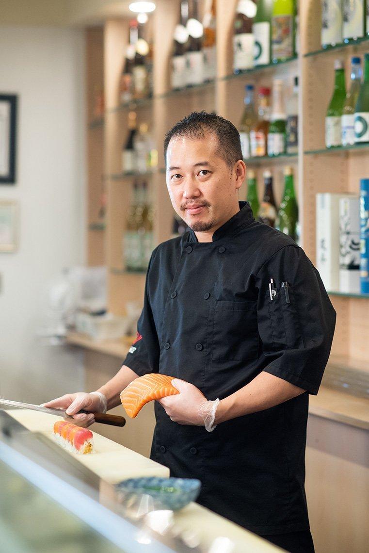 Sushi Fix chef holding fish