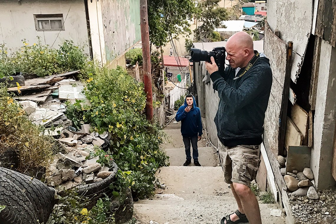 The photographer, Dean Riggott, photographing people on the streets of Tijuana Mexico.